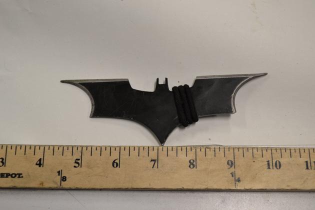 Man thinks he's Batman, throws Batman throwing stars at Police