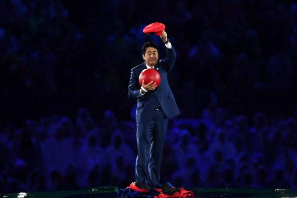 Japanese PM emerges from green pipe as Super Mario in Rio closing ceremony